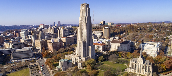 aerial view of cathedral of learning and campus buildings