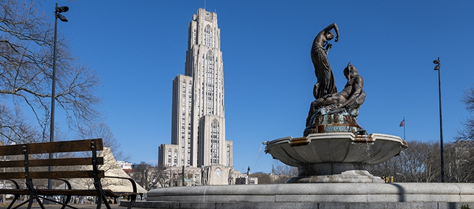 fountain statue with cathedral of learning in background