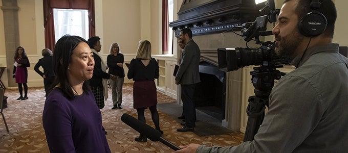 faculty members being interviewed on camera