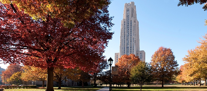 cathedral of learning with trees in fall colors