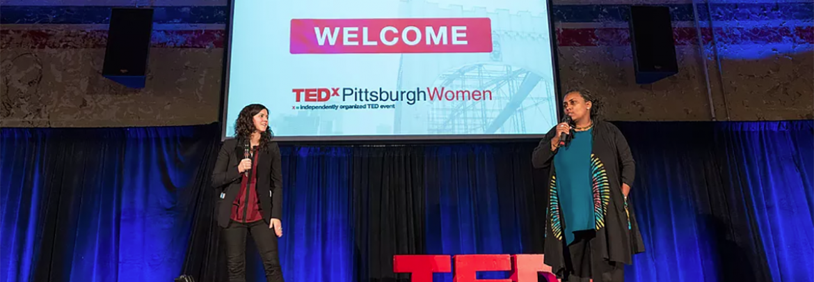 two female speakers on stage
